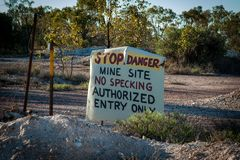 Hand painted sign for stop danger mine site no specking authorized entry only stock photography