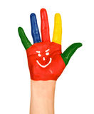 Hand painted with a smiley and colorful fingers. Painted red hand with funny smiley on an isolated white background stock photo