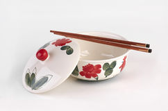 Hand painted soup bowl with cover and chopsticks Stock Image