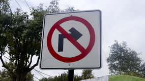 Hand painted street sign forbidden turn Stock Photo