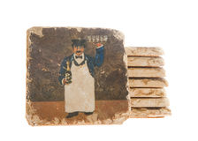 Hand painted tiles of waiter and wine Stock Photos