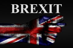 On a hand with a painted UK flag, a fig is depicted with the word BREXIT, a sign of aggression, disagreement, a dispute on a dark vector illustration