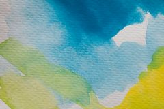 Hand painted watercolor background. Yellow and blue watercolor brush strokes on textured paper. Royalty Free Illustration