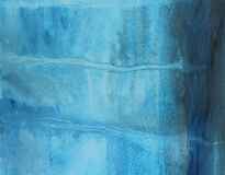 Hand painted watercolor blue background. Abstract streaks and stains on paper texture