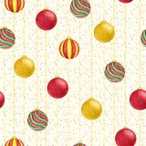 Christmas hanging balls of red, green and yellow colors seamless pattern on the starry background. New Year decoration. Stock Images