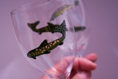 Hand painted wineglasses. Two whimsical wineglasses hand painted with fish stock images