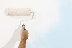 Hand painter man at work with paint roller, wall painting conc Royalty Free Stock Image