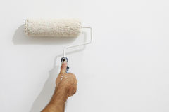 Hand painter man at work with a paint roller, wall painting. Concept Royalty Free Stock Photography