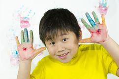 Hand painting. A child paints with his hand on a white wall Royalty Free Stock Photos