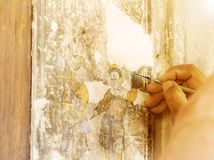 The hand of a painting artist is repairing a Chinese painting. R stock photos