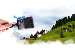 Hand Painting Ayder Plateau. Male hand holding paint brush and painting Ayder Plateau in Rize, Turkey Stock Photography