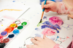 The hand is painting royalty free stock image