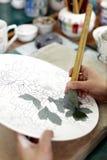 Hand-painting of Chinese ceramics Stock Image