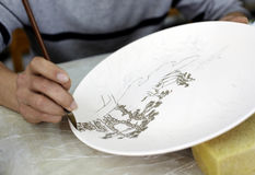 Hand-painting of Chinese ceramics Stock Photography
