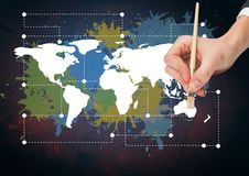 Hand painting a Colorful Map with paint splatters on wall background Stock Photos