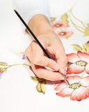 Hand Painting Floral Design. Hand Painting Colorful Floral Design On white Paper with a brush and Paints Stock Photo