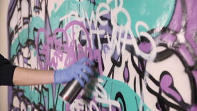 Hand painting graffiti on the wall stock video footage