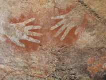 Hand painting stencil in the style of prehistoric cave art Royalty Free Stock Image