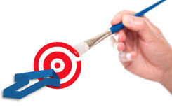Hand painting a target symbol. And arrow Stock Photo