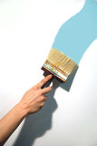 Hand painting wall  Stock Photography