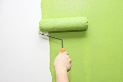 Hand painting wall in green Stock Images