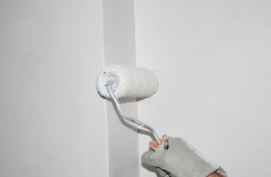 Hand painting a wall with a paint roller Royalty Free Stock Image