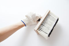 Hand painting a wall with a paintbrush Royalty Free Stock Images