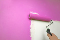 Hand painting wall pink. Closeup of the hand painting wall pink Royalty Free Stock Photo