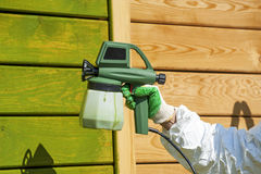 Hand painting wall with spray gun Royalty Free Stock Photo