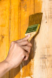 Hand painting wood boards with brush Royalty Free Stock Photography