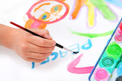 Hand painting and writing word peace Stock Photos