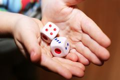 A hand with a pair of dice Royalty Free Stock Images