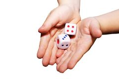A hand with a pair of dice Stock Images