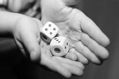 A hand with a pair of dice Stock Photos