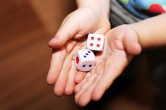 A hand with a pair of dice Royalty Free Stock Photos
