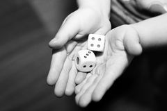 A hand with a pair of dice Royalty Free Stock Photo