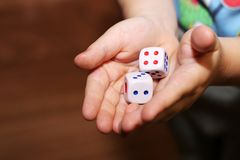 A hand with a pair of dice Royalty Free Stock Photography