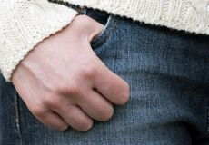 Hand in a Pair of Jeans. Person with their thumb resting in the pocket of a pair of denim jeans Stock Images
