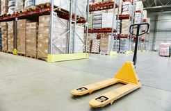 Hand pallet stacker truck at warehouse Royalty Free Stock Photography