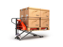 Hand pallet truck carries a pallet with boxes are  on a Royalty Free Stock Photos