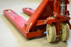 Hand pallet truck. On warehouse floor. Rear view close up image Royalty Free Stock Photos