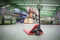 The Hand pallet truck in a warehouse Royalty Free Stock Photography