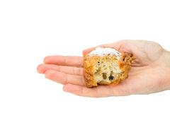 Hand palm showing partly eaten fritter or oliebol Royalty Free Stock Photo