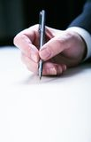 Hand  with pan. Businessman's hand  with pan on white table Stock Images