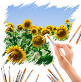 Hand with panit brushes painting a sunflowers Stock Image