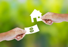 Hand with paper money and house shape Royalty Free Stock Image