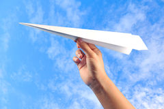 Hand with paper plane Royalty Free Stock Photography