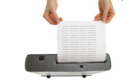 Hand and paper shredder Royalty Free Stock Image