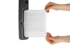 Hand and paper shredder Royalty Free Stock Photography