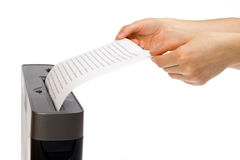 Hand and paper shredder Royalty Free Stock Photo